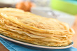 Fresh homemade crepes piled on plate (Selective Focus)