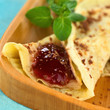 Fresh homemade crepe filled with strawberry jam