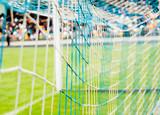 mesh football goal on the stadium poster