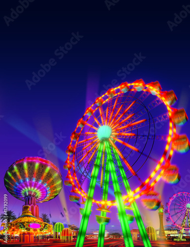 theme park motor rides game in night view with blue purple sky