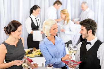Business woman take aperitif from waiter