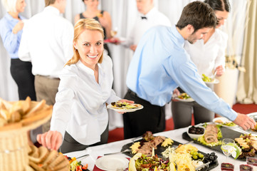 Business woman serve herself at buffet