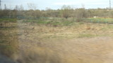 View from high-speed train window on the fields in spring