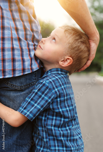 Son hugging his father