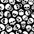 Skulls in Black Background Seamless Pattern
