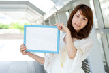 Beautiful young woman with message board. Portrait of asian.