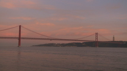 Lisbon bridge boats time lapse sunset
