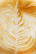 Coffee cup with artistic cream decoration