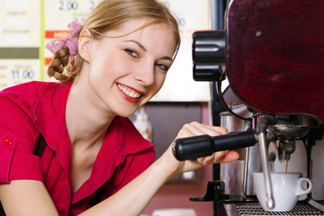 Friendly waitress making coffee