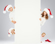 Happy family in Santa's hats. It is good for Christmas advertise