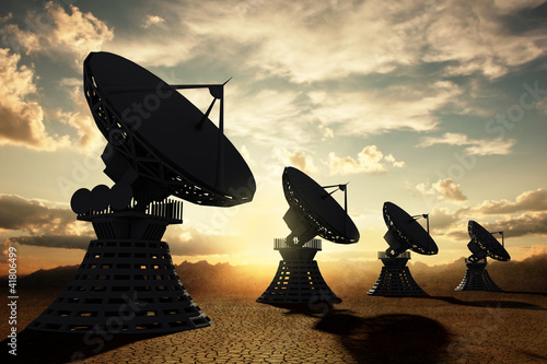 Radiotelescopes silouette at sunset