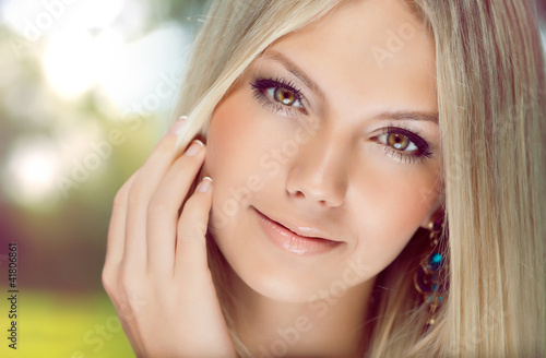 Portrait of  beautiful young  woman with blonde hair close-up