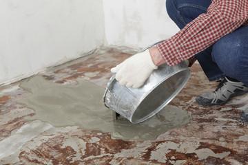 Construction worker pouring wet concrete