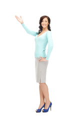 attractive businesswoman pointing her hand