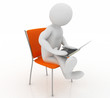 a man sits on a chair with laptop