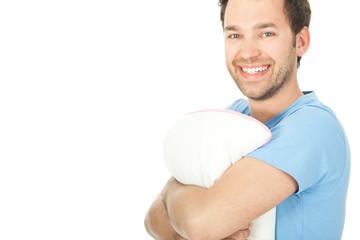 junger mann mit einem Kissen