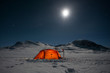 canvas print picture - Moon over a illuminated Tent on a Winter Expedition
