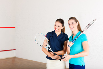 Squash racket sport in gym, women training