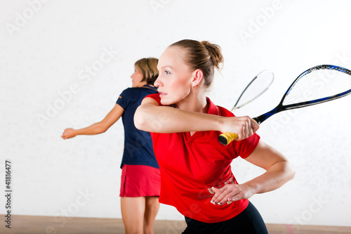 Squash racket sport in gym
