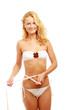 A young beautiful woman measuring her waist
