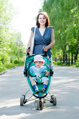 woman with stroller  at summer park