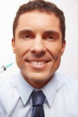 Lachender Manager bei Schönheitschirurgie