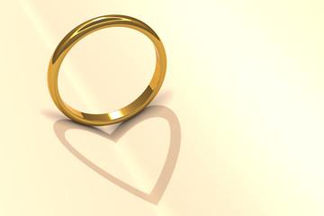 金色の指輪とハートの影