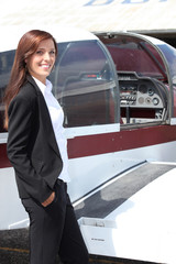 Female pilot and her light aircraft