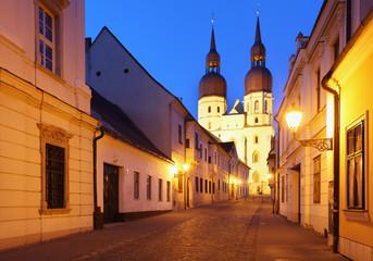 Historical street in Trnava with Saint Nicolas church Slovakia