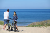 Couple with bicycles looking at the ocean - Fine Art prints