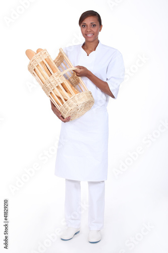 Brunette woman with a basket of bread