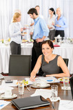 Fototapety Business woman work during catering buffet
