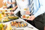 Business people take buffet appetizers