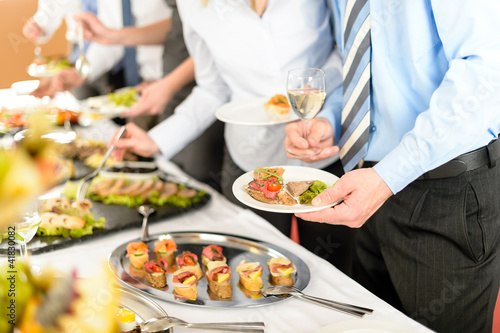 Keuken foto achterwand Buffet, Bar Business people take buffet appetizers