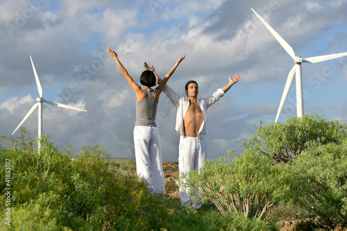 Couple stood in wind farm