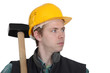 Young manual worker stood with sledge-hammer