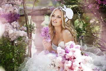 portrait of a bride with a bouquet of lilacs