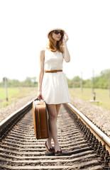 Fashion red-head girl at railways.
