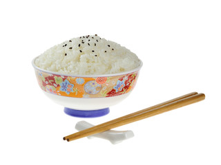 Rice in a ceramic bowl with chopsticks