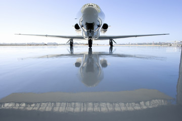 Aeroplane on runway, reflection on ground