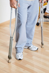 Woman Standing With Crutches