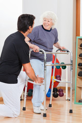 Woman With Walker Looking At Trainer