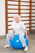 Happy Senior Woman Sitting On Fitness Ball