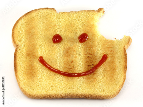 Bread with happy face and bite
