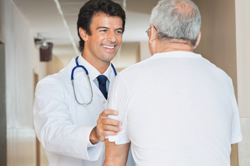 Doctor Assisting Senior Man