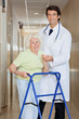 Doctor Helping An Old Woman With Her Walker