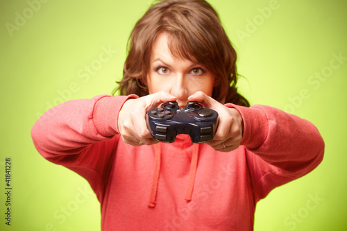 Beautiful womanl with gamepad playing vieogame