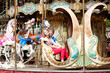 Happy young couple at vintage Parisian merry-go-round