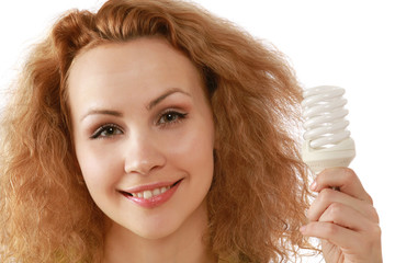 Closeup of a girl with an energy-saving bulb