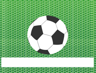 Soccer ball on green grass abstract background